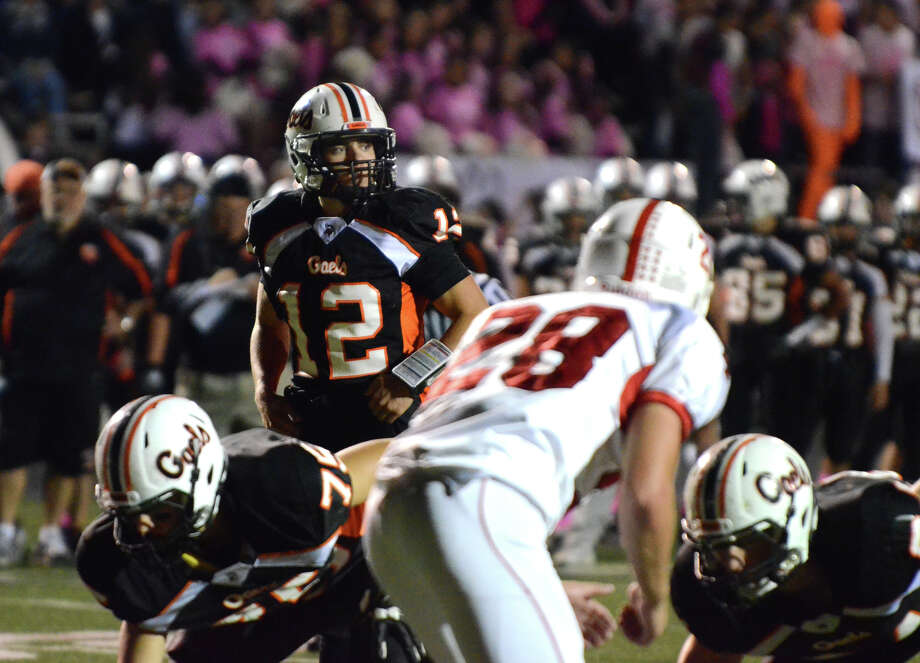 Shelton's quarterback Mark Piccirillo (12) on the line during the football game against Fairfield Prep at Shelton High School on Friday, Oct. 11, 2013. Photo: Amy Mortensen / Connecticut Post Freelance