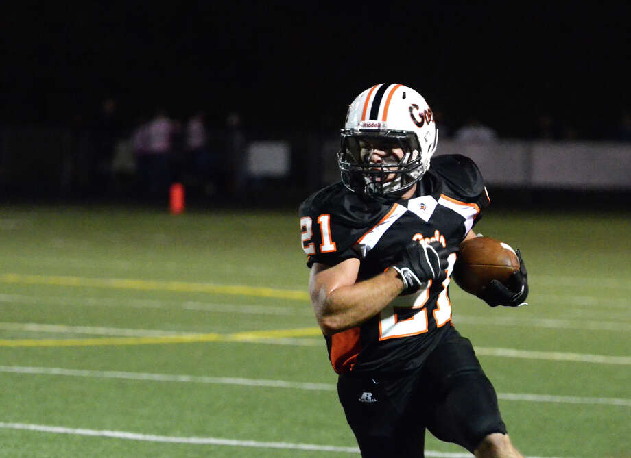 Shelton's Jason Thompson (21) carries the ball during the football game against Fairfield Prep at Shelton High School on Friday, Oct. 11, 2013. Photo: Amy Mortensen / Connecticut Post Freelance