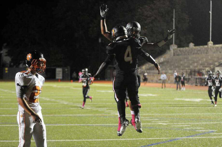Stamford's Jerry Aime and Cameron Webb celebrate a touchdown as Stamford High School hosts Ridgefield in a football game in Stamford, Conn., Oct. 11, 2013. Photo: Keelin Daly / Stamford Advocate Freelance