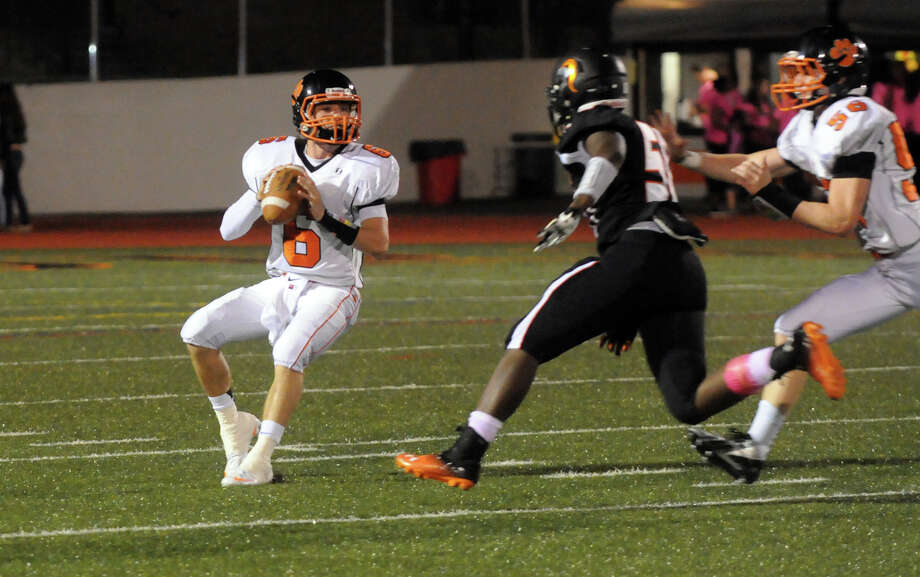 Ridgefield quarterback Ryan Dunn under pressure as Stamford High School hosts Ridgefield in a football game in Stamford, Conn., Oct. 11, 2013. Photo: Keelin Daly / Stamford Advocate Freelance