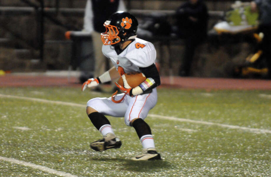 Ridgefield's Jack Boscia in action as Stamford High School hosts Ridgefield in a football game in Stamford, Conn., Oct. 11, 2013. Photo: Keelin Daly / Stamford Advocate Freelance