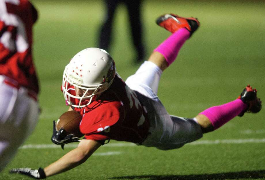 Greenwich's Tommy Rappa dives into the end zone for a touchdown during Friday's football game at Greenwich High School on October 11, 2013. Photo: Lindsay Perry / Stamford Advocate