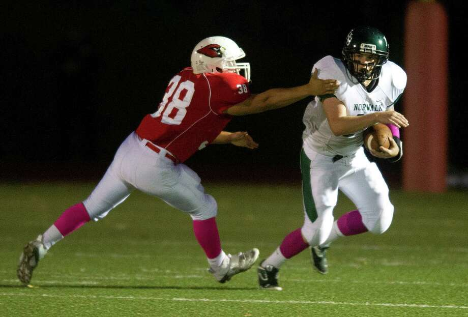 Greenwich's Luca Gabriele reaches for Norwalk's Jared Smith during Friday's football game at Greenwich High School on October 11, 2013. Photo: Lindsay Perry / Stamford Advocate