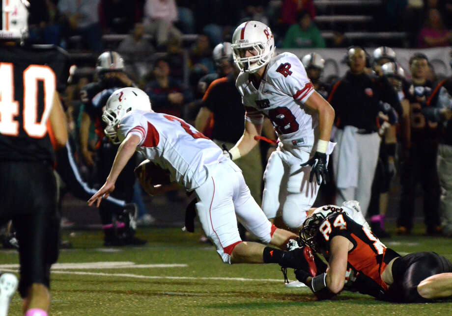 Shelton's Kyle Drost (84) grabs hold of Fairfield Prep's Colton Smith (2) during the football game at Shelton High School on Friday, Oct. 11, 2013. Photo: Amy Mortensen / Connecticut Post Freelance