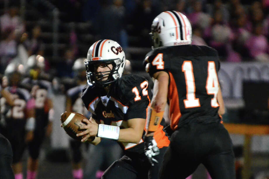 Shelton's quarterback Mark Piccirillo (12) looks to pass during the football game against Fairfield Prep at Shelton High School on Friday, Oct. 11, 2013. Photo: Amy Mortensen / Connecticut Post Freelance