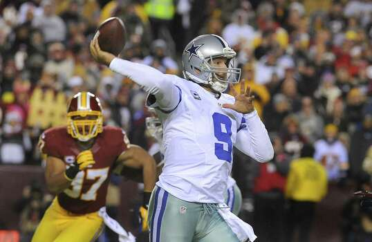 The Redskins' defense overwhelmed Tony Romo and the Cowboys in last year's regular- season finale that denied Dallas a trip to the playoffs. Washington forced Romo into three interceptions and sacked him twice. Photo: Richard Lipski / Associated Press