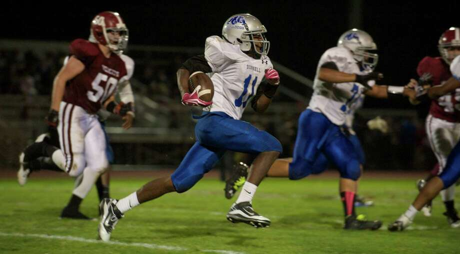 Bunnell's Justin Townsend, 11, runs to the outside corner during a boys High School football game between Bunnell High School and Bethel High School in Bethel, Conn, on Friday, October 11, 2013. Photo: H John Voorhees III / The News-Times Freelance