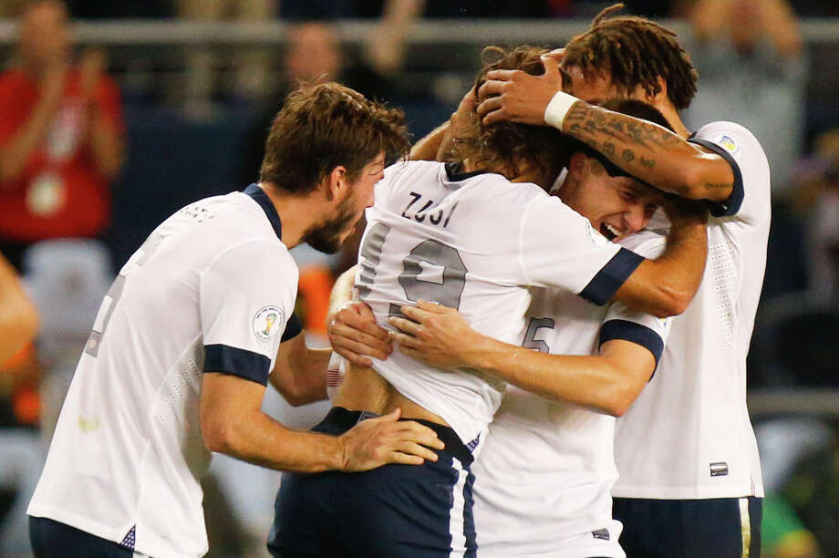KANSAS CITY, KS - OCTOBER 11:  Graham Zusi #19 of the U.S. Men's National Soccer Team celebrates after scoring the first goal of the game against Jamaica in the second half at Sporting Park on October 11, 2013 in Kansas City, Kansas. Photo: Kyle Rivas, Getty Images / 2013 Getty Images