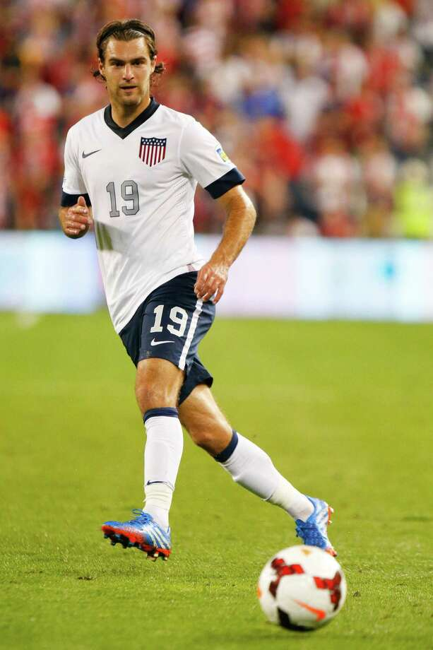 KANSAS CITY, KS - OCTOBER 11:  Graham Zusi #19 of the U.S. Men's National Soccer Team passes the ball against Jamaica early in the second half at Sporting Park on October 11, 2013 in Kansas City, Kansas. Photo: Kyle Rivas, Getty Images / 2013 Getty Images