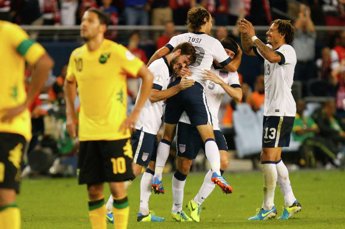 KANSAS CITY, KS - OCTOBER 11: Graham Zusi #19 of the U.S. Men's National Soccer Team celebrates after scoring the first goal of the game against Jamaica in the second half at Sporting Park on October 11, 2013 in Kansas City, Kansas.