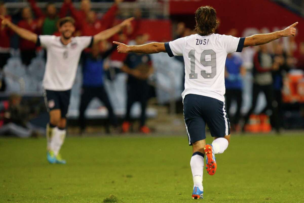 KANSAS CITY, KS - OCTOBER 11: Graham Zusi #19 of the U.S. Men's National Soccer Team celebrates after scoring the first goal of the game against Jamaica midway in the second half at Sporting Park on October 11, 2013 in Kansas City, Kansas.