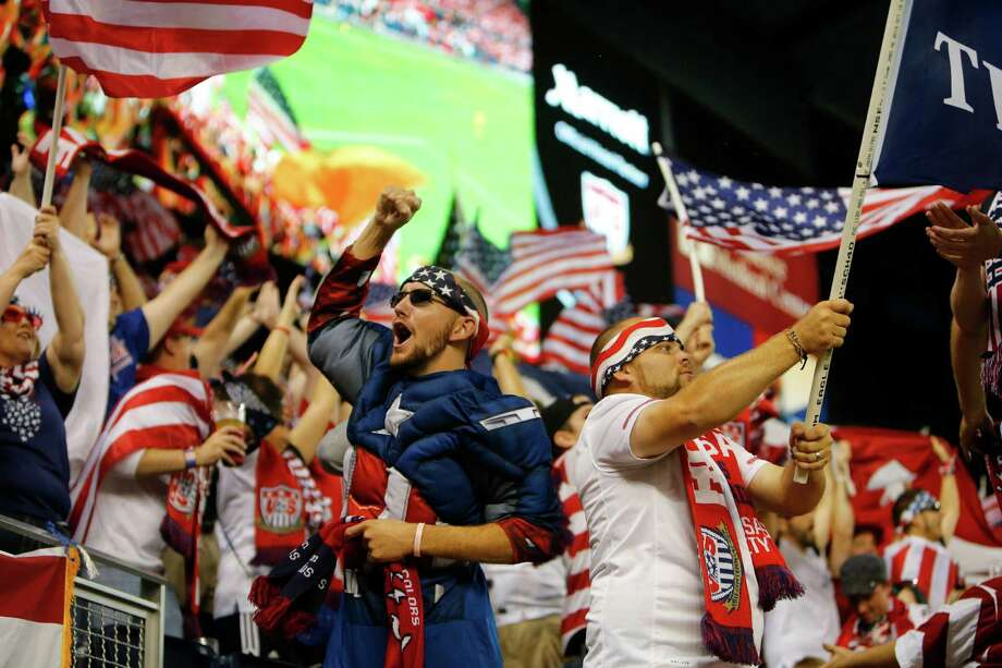 KANSAS CITY, KS - OCTOBER 11:  A fan dressed as Captain America celebrates after the U.S. Men's National Soccer Team scored the first goal against Jamaica at Sporting Park on October 11, 2013 in Kansas City, Kansas. Photo: Kyle Rivas, Getty Images / 2013 Getty Images