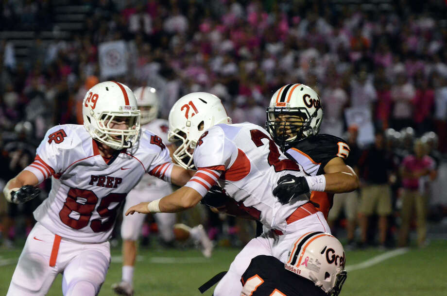 Fairfield Prep's Andrew Vegliante (21) carries the ball as Shelton's Marquet Humphrey (6) defends during the football game at Shelton High School on Friday, Oct. 11, 2013. Photo: Amy Mortensen / Connecticut Post Freelance