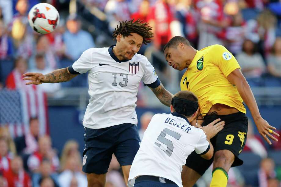 KANSAS CITY, KS - OCTOBER 11:  Jermaine Jones #13 and Matt Besler #5 of the U.S. Men's National Soccer Team defend against Ryan Johnson #9 of Jamaica during a corner kick in the first half at Sporting Park on October 11, 2013 in Kansas City, Kansas. Photo: Kyle Rivas, Getty Images / 2013 Getty Images