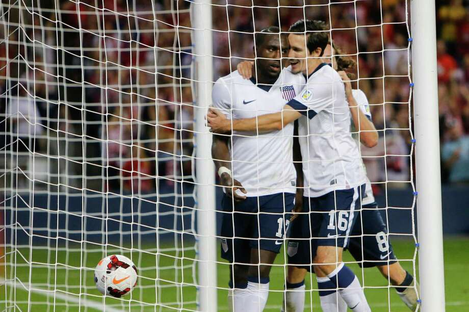 KANSAS CITY, KS - OCTOBER 11:  Sacha Kljestan #16 and Mix Diskerud #8 of the U.S. Men's National Soccer Team celebrate the second goal of the game scored by Jozy Altidore #17 against Jamaica at Sporting Park on October 11, 2013 in Kansas City, Kansas. Photo: Kyle Rivas, Getty Images / 2013 Getty Images