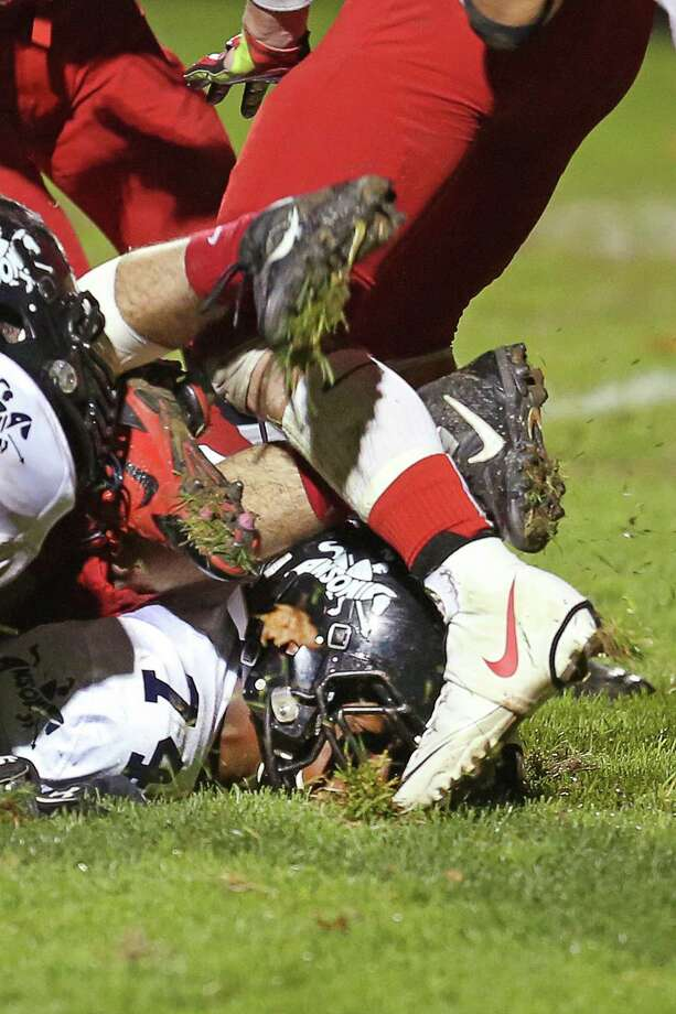 Mike Ross Connecticut Post freelance - Ansonia High School's offensive lineman #74 Tyler Reese gets a face full of turf while protecting the line as teammate #1 Jaiquan McKnight scores a first half touchdown against Derby High School. Ansonia would win 62-28 over Derby. Photo: Mike Ross / Mike Ross Connecticut Post freelance - @www.mikerossphoto.com