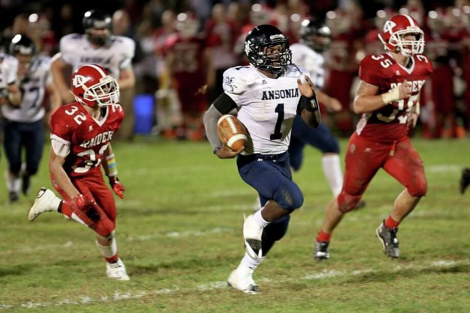 Mike Ross Connecticut Post freelance - Ansonia High School's quarterback #1  Jaiquan McKnight goes for a long yardage quarterback sneak touchdown run during Friday evening game between Derby High School. Ansonia would remain un-defeated and winning the game 62-28. Photo: Mike Ross / Mike Ross Connecticut Post freelance - @www.mikerossphoto.com