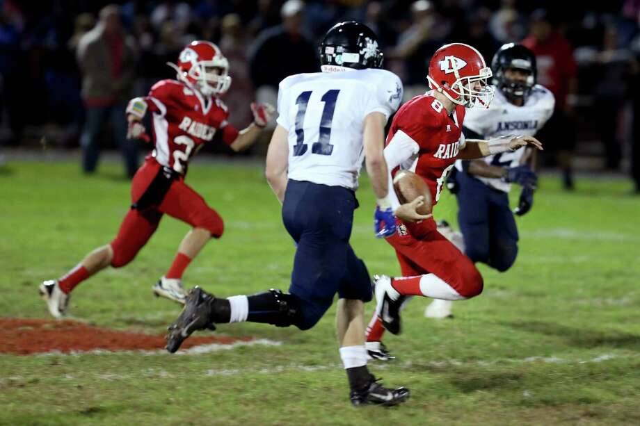 Mike Ross Connecticut Post freelance -Derby High School's quarterback #8 Michael Kreiger goes for a first down during a qb sneak run as Ansonia High School defense # 11 Witod Gul and #2 Arkeel Newsome give chase. Ansonia would win the match up 62-28. Photo: Mike Ross / Mike Ross Connecticut Post freelance - @www.mikerossphoto.com
