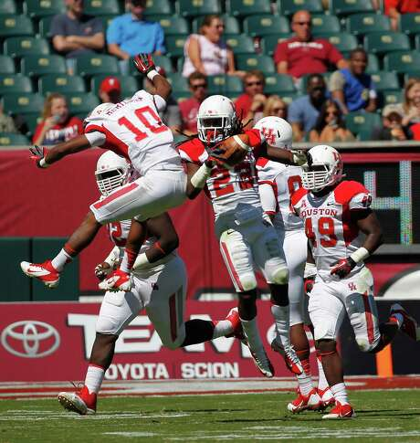 UH defensive back Trevon Stewart (23) and teammate Zachary McMillian (10) have helped the UH defense do its part with plenty of takeaways, allowing the Cougars to race out to a NCAA-high plus-11 turnover margin. Photo: Johnny Hanson, Staff / © 2013  Houston Chronicle