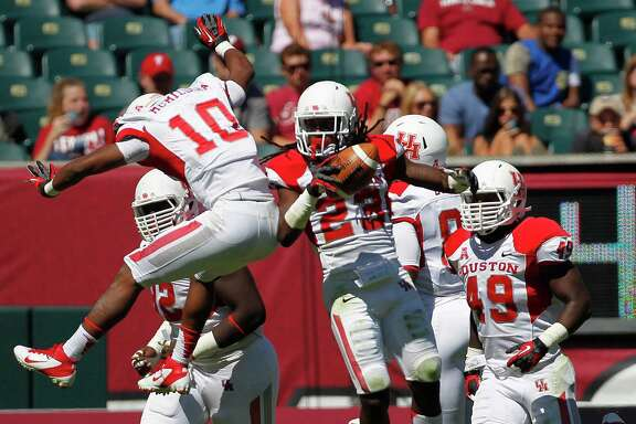 UH defensive back Trevon Stewart (23) and teammate Zachary McMillian (10) have helped the UH defense do its part with plenty of takeaways, allowing the Cougars to race out to a NCAA-high plus-11 turnover margin.