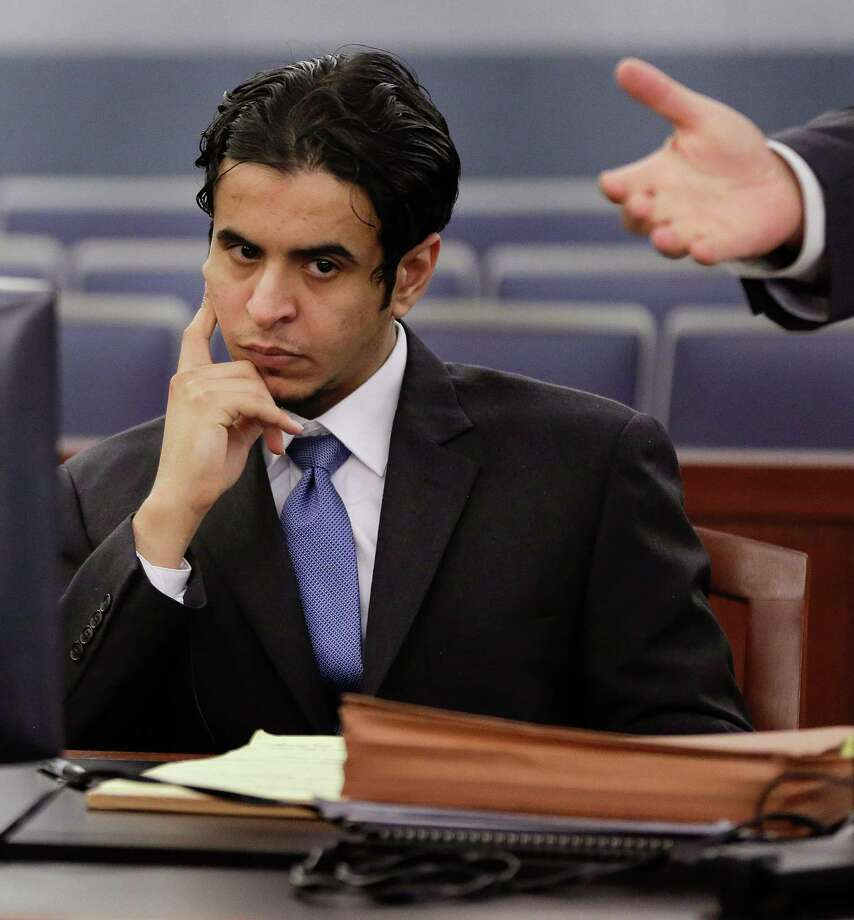 Defendant Mazen Alotaibi, listens to comments by his defense attorney, Don Chairez during the jury selection process for hit trial, Friday, Oct. 11, 2013, at Justice Court in Las Vegas.  The 24-year-old Saudi Arabian air force sergeant is charged with raping a 13-year-old boy at a Las Vegas Strip hotel.  (AP Photo/Julie Jacobson) ORG XMIT: NVJJ104 Photo: Julie Jacobson / AP