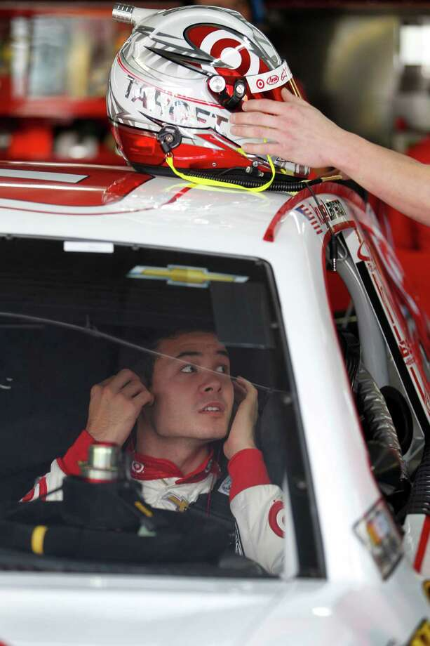 Kyle Larson waits in his car during practice for Saturday's NASCAR Sprint Cup series auto race at Charlotte Motor Speedway in Concord, N.C., Thursday, Oct. 10, 2013. (AP Photo/Terry Renna) ORG XMIT: NCCB126 Photo: Terry Renna / FR60642 AP