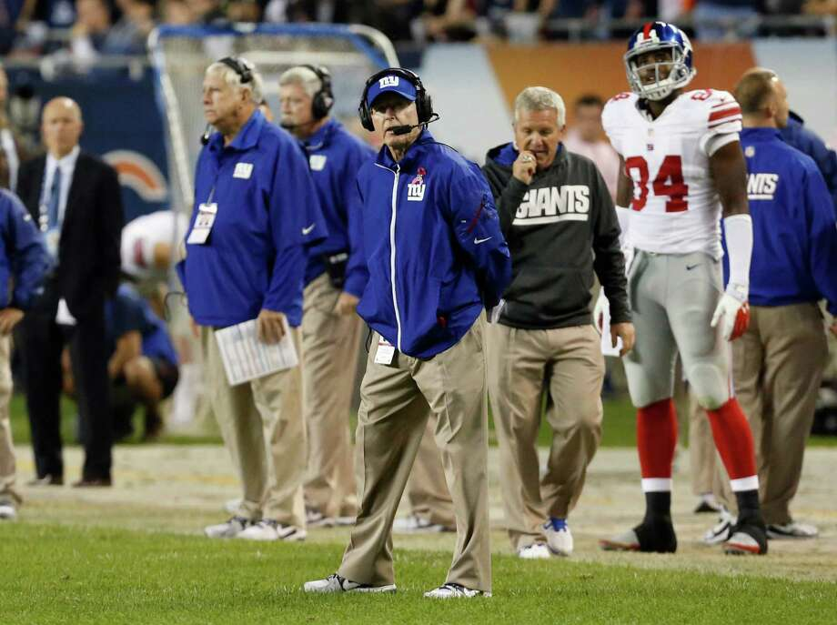 New York Giants coach Tom Coughlin looks at the scoreboard in the second half of an NFL football game against the Chicago Bears, Thursday, Oct. 10, 2013, in Chicago. The Bears won 27-21. (AP Photo/Charles Rex Arbogast) ORG XMIT: CXB194 Photo: Charles Rex Arbogast / AP