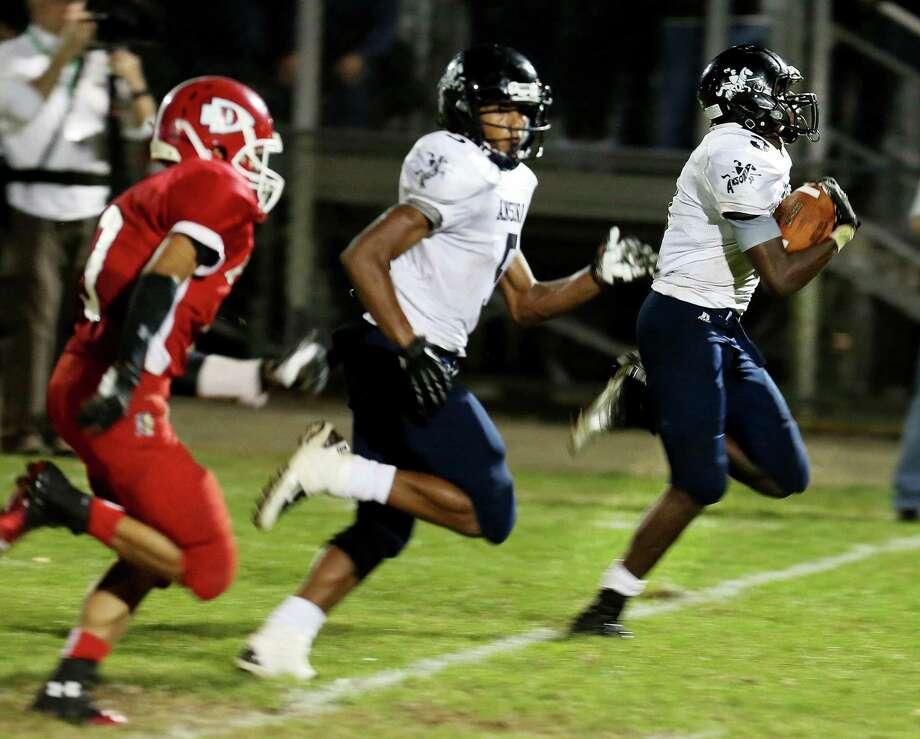 Mike Ross Connecticut Post freelance - Ansonia High School's captain #3 Saiheed Sanders moves the ball for a long yardage run during Friday evening match-up against Derby High School. Ansonia would remain un-defeated with a 62-28 victory. Photo: Mike Ross / Mike Ross Connecticut Post freelance - @www.mikerossphoto.com