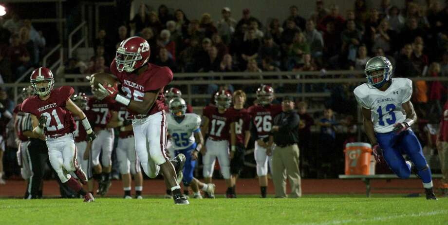 Bethel's Andre Hayles, 25, intercepts a pass during a football game between Bunnell High School and Bethel High School in Bethel, Conn, on Friday, October 11, 2013. Photo: H John Voorhees III / The News-Times Freelance