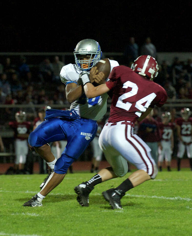 Bunnell's Zhyaire Fernandes, 25, is hit by Bethel's Nicholas Silva, 24 during a football game between Bunnell High School and Bethel High School in Bethel, Conn, on Friday, October 11, 2013. Photo: H John Voorhees III / The News-Times Freelance