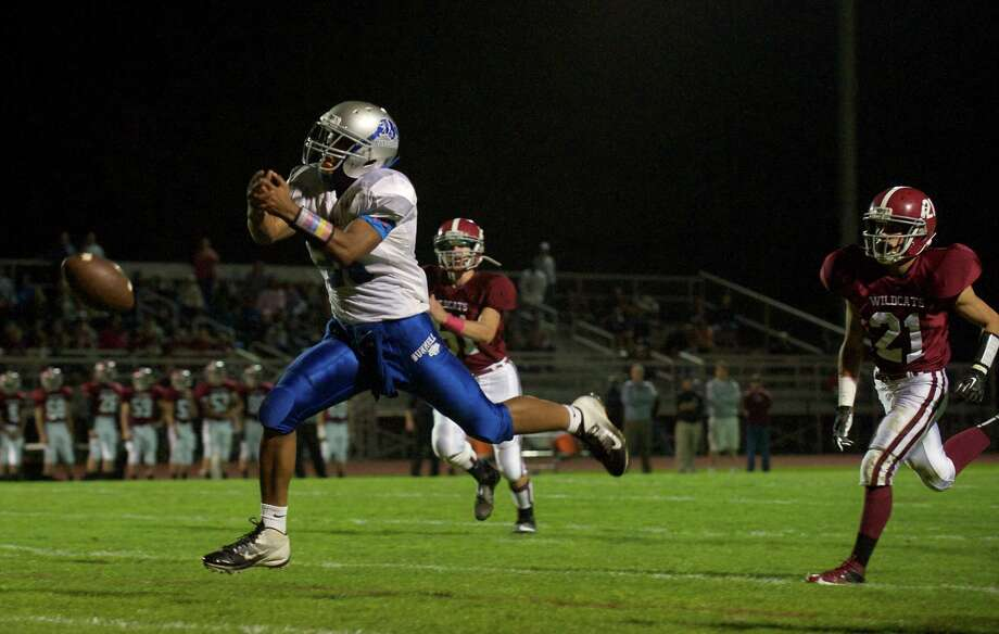 The ball is just out of the reach of Bunnell's Zhyaire Fernandes, 25, during a  football game between Bunnell High School and Bethel High School in Bethel, Conn, on Friday, October 11, 2013. Photo: H John Voorhees III / The News-Times Freelance