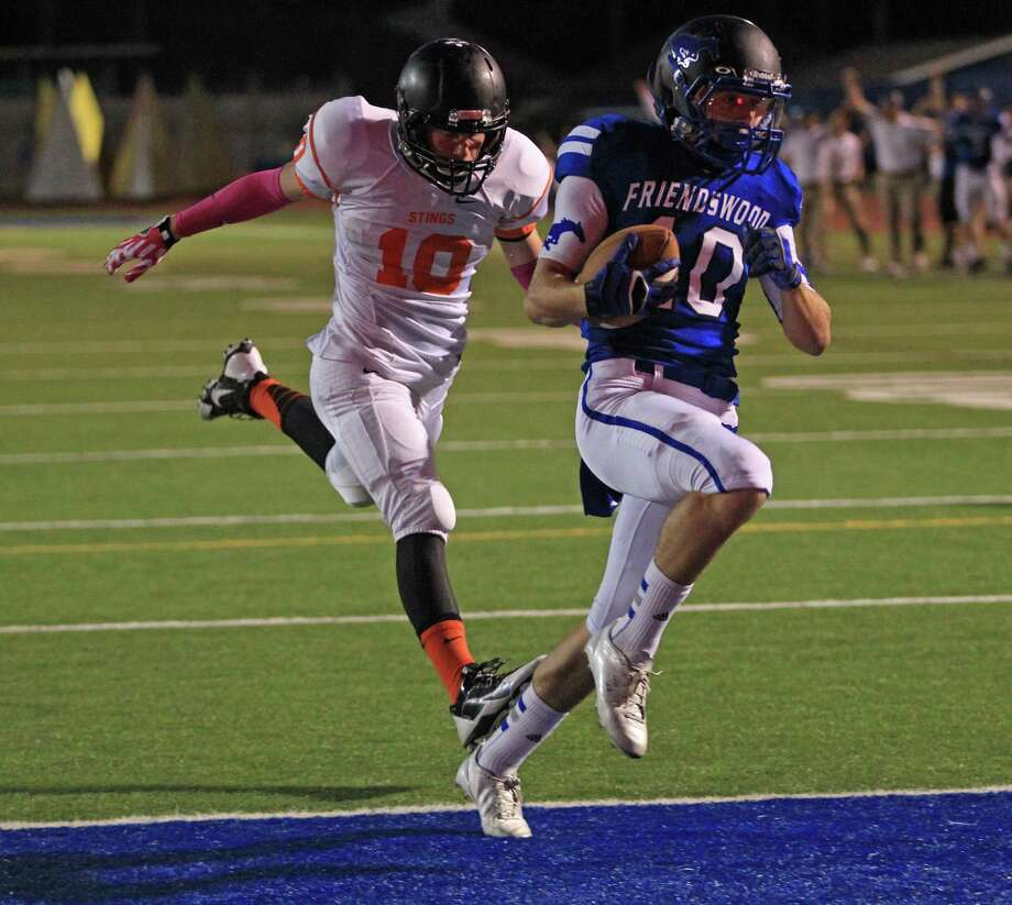 Friendswood's Slade Holle, right, scores a 60-yard touchdown reception past Texas City's Nathan Stahl during the first half of a high school football game, Friday, October 11, 2013 at Henry Winston Stadium in Friendswood. Photo: Eric Christian Smith, For The Chronicle