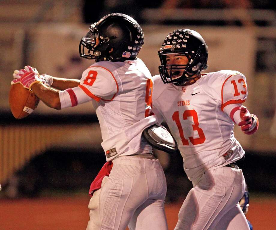 Texas City's Andrew Allen (8) celebrates a reception with teammate Tres Rodriguez during the first half of a high school football game against Friendswood, Friday, October 11, 2013 at Henry Winston Stadium in Friendswood. Photo: Eric Christian Smith, For The Chronicle