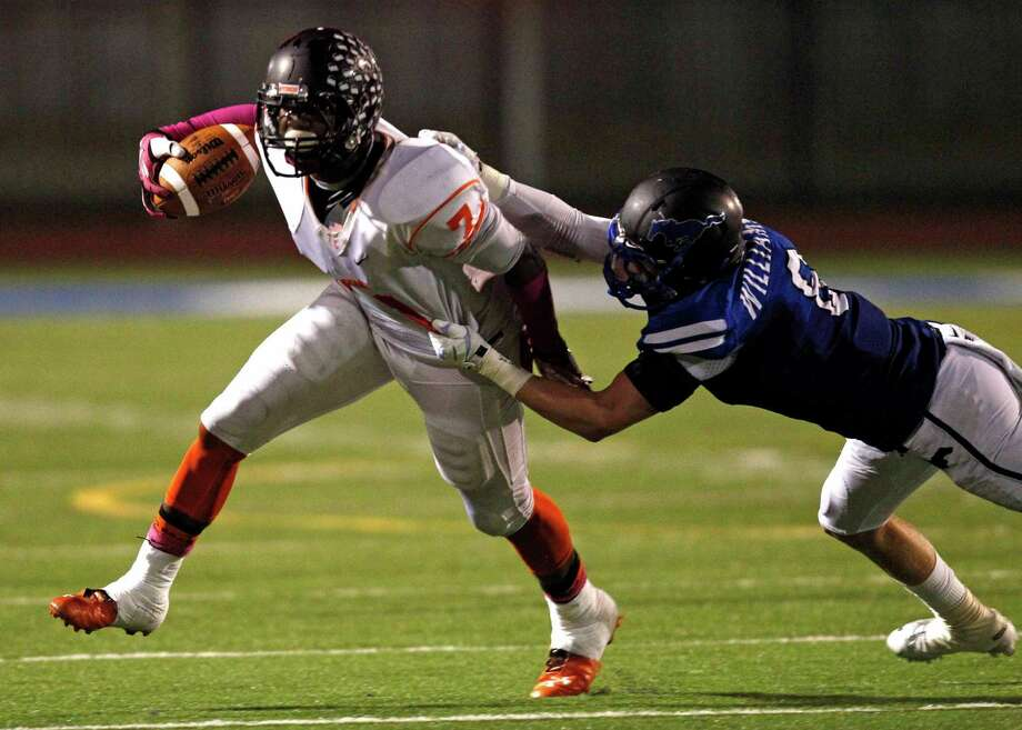 Texas City's D'onta Foreman (7) is tackled by Friendswood's Walker Williams during the first half of a high school football game, Friday, October 11, 2013 at Henry Winston Stadium in Friendswood. Photo: Eric Christian Smith, For The Chronicle