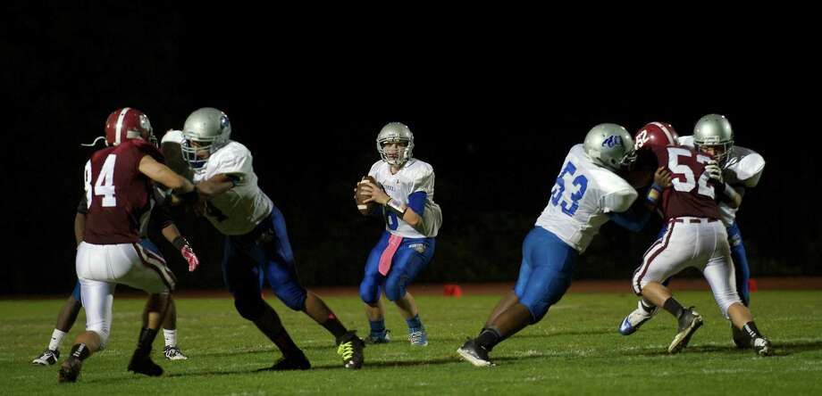 Game action from the boys football game between Bunnell High School and Bethel High School in Bethel, Conn, on Friday, October 11, 2013. Photo: H John Voorhees III / The News-Times Freelance