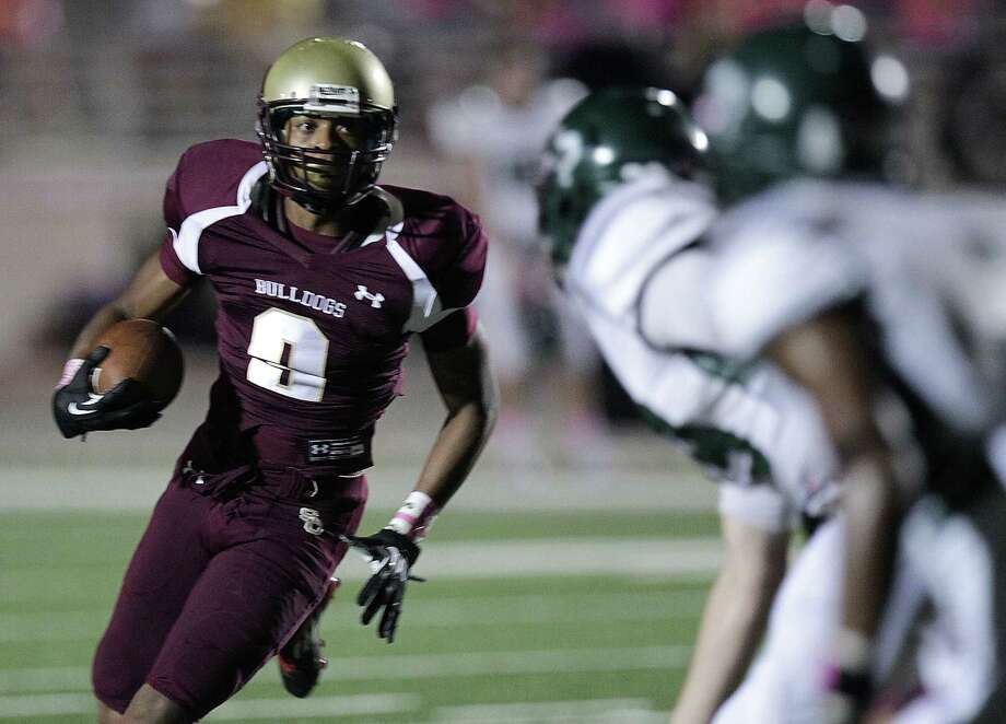 Summer Creek's Corrion Ballard left, runs the ball against Kingwood during the second quarter of high school football game action at Humble ISD's Turner Field Friday, Oct. 11, 2013, in Humble. Photo: James Nielsen, Houston Chronicle / © 2013  Houston Chronicle