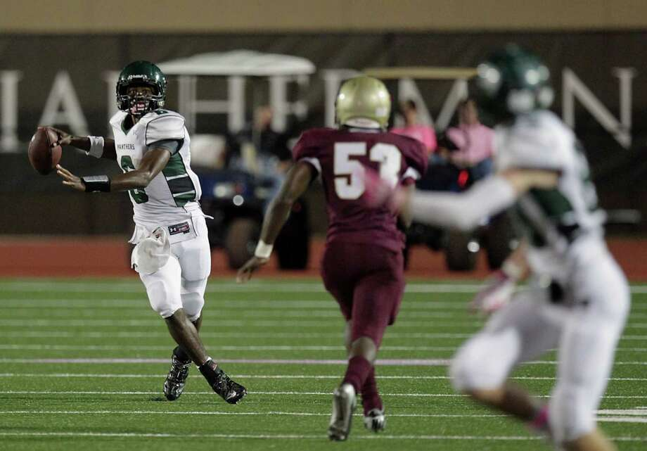 Kingwood's quarterback Jaylon Henderson left, sets up to throw a pass against Summer Creek during the second quarter of high school football game action at Humble ISD's Turner Field Friday, Oct. 11, 2013, in Humble. Photo: James Nielsen, Houston Chronicle / © 2013  Houston Chronicle