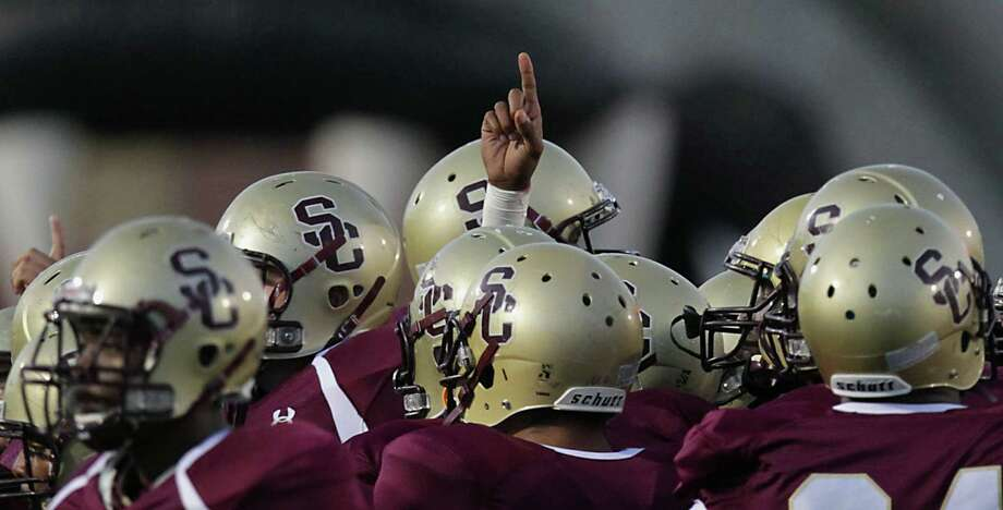 Summer Creek in a pre-game huddle before facing Kingwood in Friday's high school football game at Humble ISD's Turner Field, Oct. 11, 2013, in Humble. Photo: James Nielsen, Houston Chronicle / © 2013  Houston Chronicle