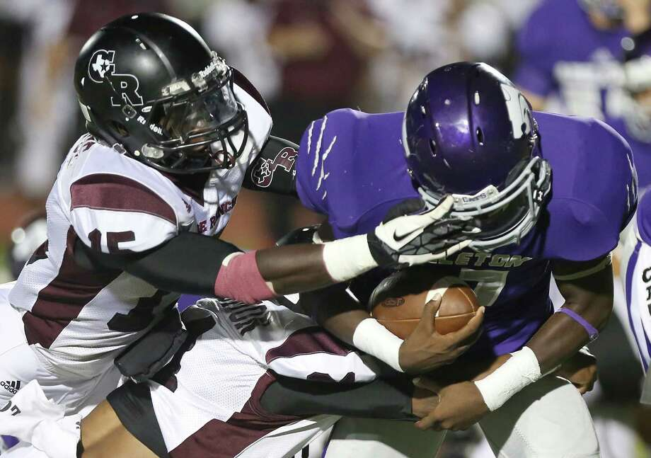 George Ranch 31, Angleton 2410/11/13: George Ranch's  Alfred Wande face mask Angleton's Dayshawn Franklin #37 in a High School football game in Angleton, Texas. Then was no penalty on the play. Photo: Thomas B. Shea, Houston Chronicle / © 2013 Thomas B. Shea