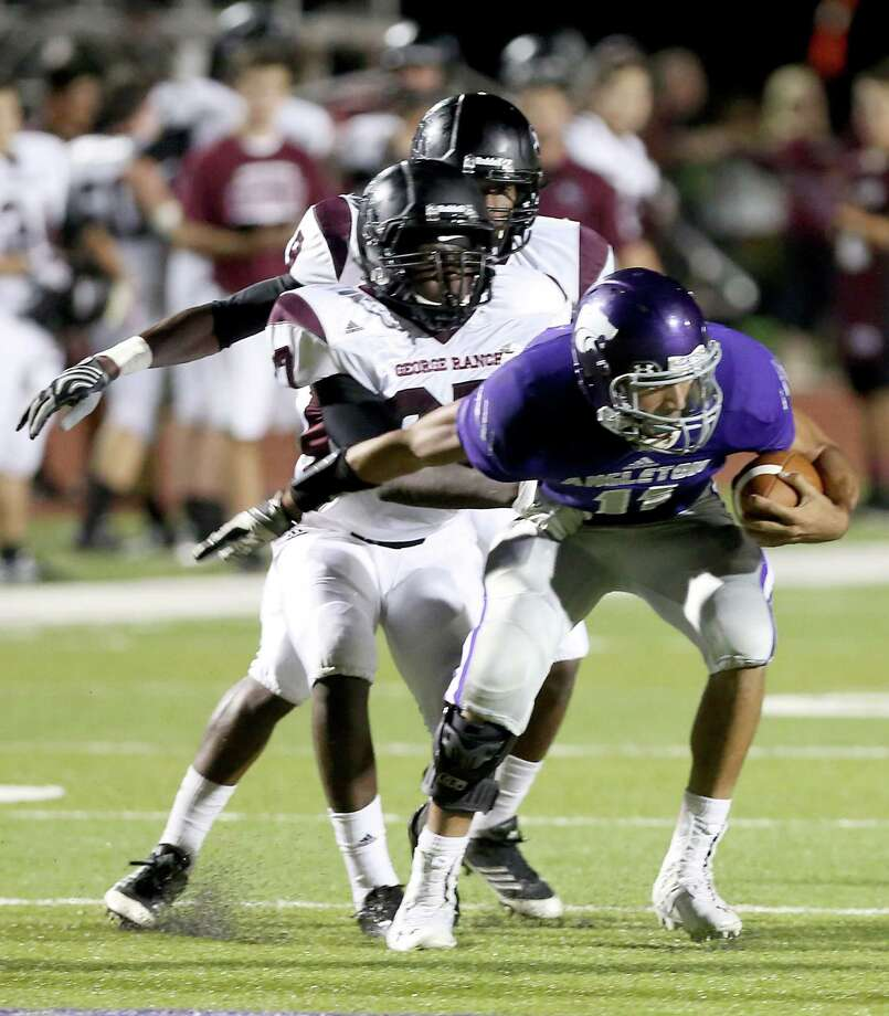 10/11/13: Angleton's Thomas Josey #2 is tackled by George Ranch's Quincy Wande #27 in a High School football game in Angleton, Texas. Photo: Thomas B. Shea, Houston Chronicle / © 2013 Thomas B. Shea
