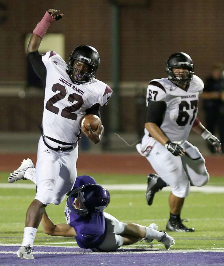 10/11/13: George Ranch's Collins Kwebena #22 breaks the tackle of  an Angleton's defender in a High School football game in Angleton, Texas. Photo: Thomas B. Shea, Houston Chronicle / © 2013 Thomas B. Shea