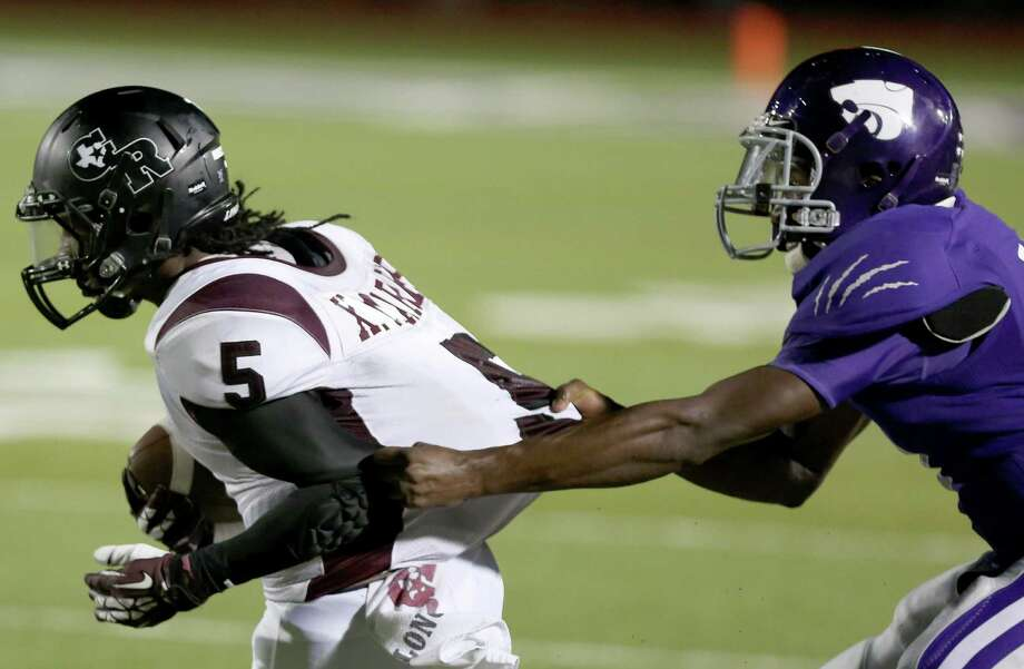 10/11/13: George Ranch's  Vavian Marks #5 is tackled by Angleton defender  in a High School football game in Angleton, Texas. Photo: Thomas B. Shea, Houston Chronicle / © 2013 Thomas B. Shea