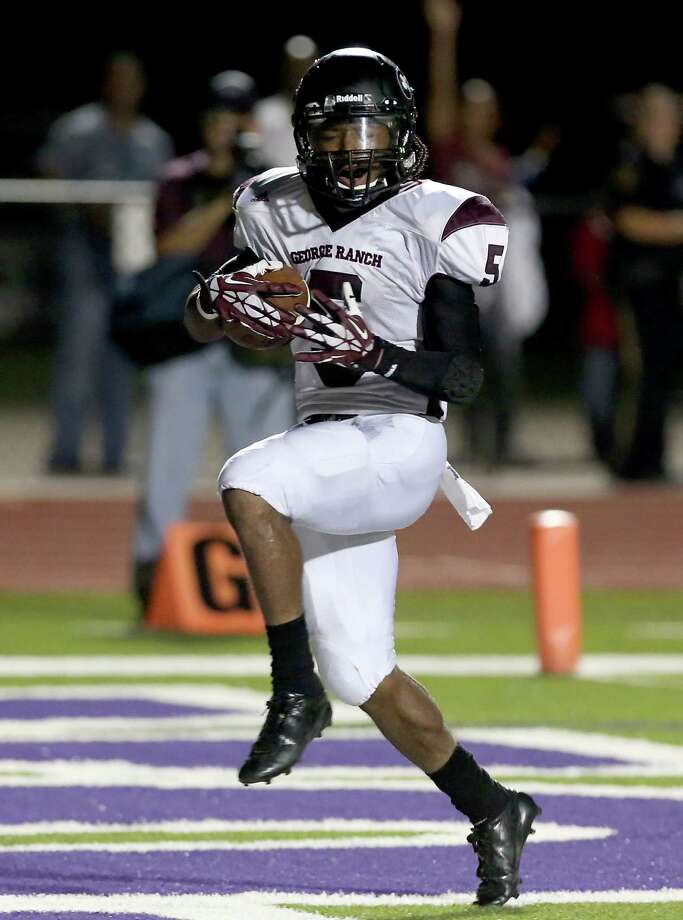 10/11/13: George Ranch's  Xavian Marks #5 high steps into the end zone after rushing for  23 yard touchdown against Angleton in a High School football game in Angleton, Texas. Photo: Thomas B. Shea, Houston Chronicle / © 2013 Thomas B. Shea