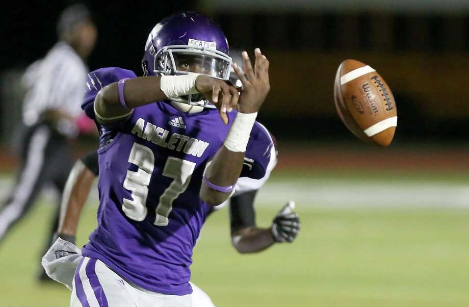 10/11/13: Angleton's  Dayshawn Franklin #37 drops a pass against George Ranch in a High School football game in Angleton, Texas. Photo: Thomas B. Shea, Houston Chronicle / © 2013 Thomas B. Shea