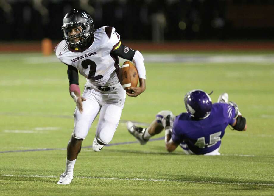 10/11/13: George Ranch's Timon Nolan #2 runs past Angleton's Marcus Ramirez #45 in a High School football game in Angleton, Texas. Photo: Thomas B. Shea, Houston Chronicle / © 2013 Thomas B. Shea