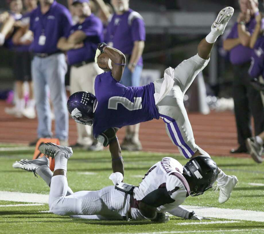 10/11/13: Angleton's K'Vonte Jackson is tripped up on the kickoff by George Ranch's  Darius Anderson #1in a High School football game in Angleton, Texas. Photo: Thomas B. Shea, Houston Chronicle / © 2013 Thomas B. Shea