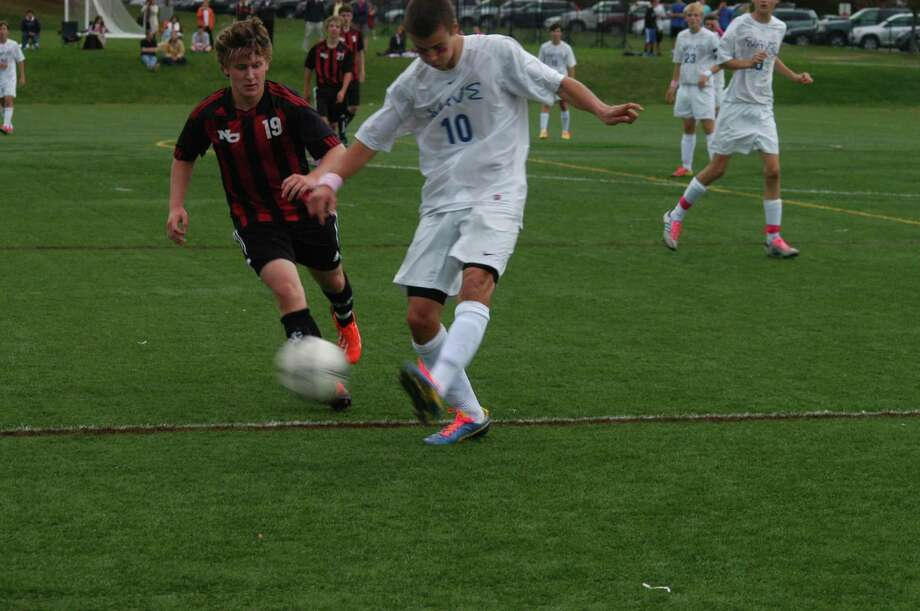 Darien's Kai Bjornstad (No. 10) controls the ball during Darienís 3-0 win over New Canaan at Darien High School on Friday, Oct. 11, 2013. By Andy Hutchison Photo: Contributed Photo / Darien News