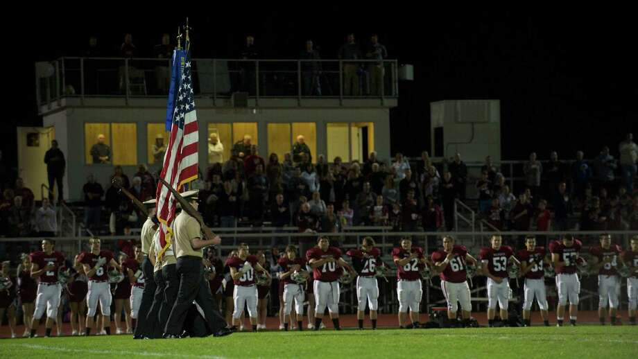 The Stars & Stripes are brought out onto the field before the start of the boys football game between Bunnell High School and Bethel High School in Bethel, Conn, on Friday, October 11, 2013. Photo: H John Voorhees III / The News-Times Freelance