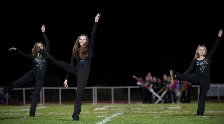 Ashley Johnson of the BHS Dance Team, center, during half time of the boys football game between Bunnell High School and Bethel High School in Bethel, Conn, on Friday, October 11, 2013. Photo: H John Voorhees III / The News-Times Freelance