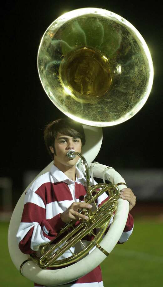 Bethel High School Marching Band member and tuba player Andre Morais, age 15, during halftime of the boys high school football game between Bunnell High School and Bethel High School in Bethel, Conn, on Friday, October 11, 2013. Photo: H John Voorhees III / The News-Times Freelance